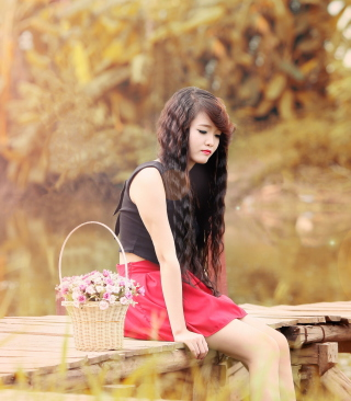 Free Sad Asian Girl With Flower Basket Picture for Nokia Asha 306