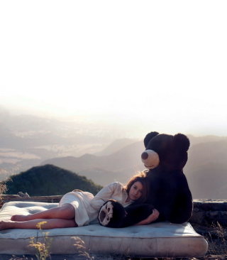 Girl Hugging A Big Teddy Bear Background for Nokia C1-01