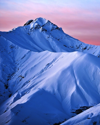 Free Snowy Mountains And Purple Horizon Picture for Nokia Asha 311