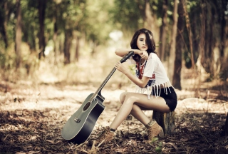 Pretty Brunette Model With Guitar At Meadow Background for Android, iPhone and iPad
