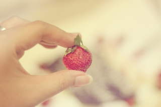 Free Strawberry In Her Hand Picture for Android, iPhone and iPad