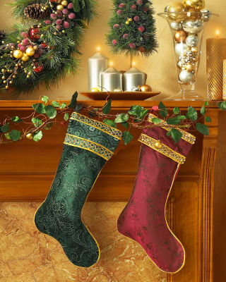 Christmas stocking on fireplace Wallpaper for Nokia Asha 310