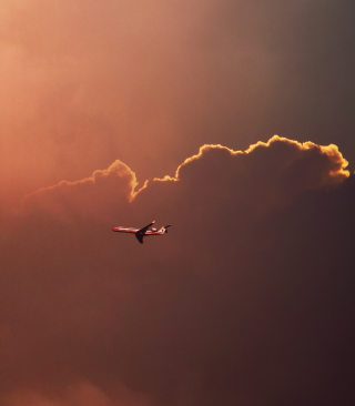 Airplane In Red Sky Above Clouds - Obrázkek zdarma pro 352x416
