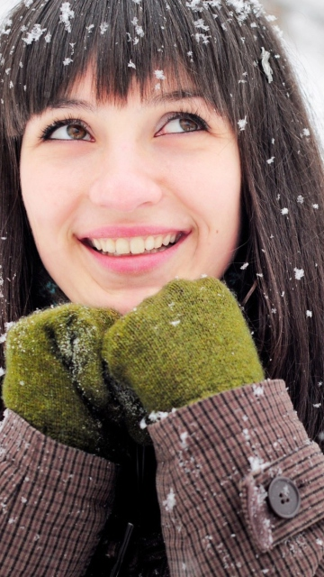 Brunette With Green Gloves In Snow