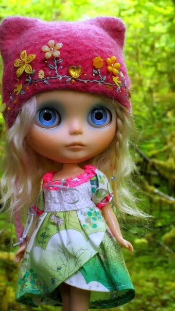 Cute Blonde Doll In Forest