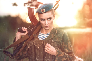 Russian Girl and Weapon HD Background for Sony Xperia Z2 Tablet