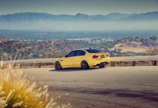 Yellow Bmw M3 E90 Mountain Road Background for Android, iPhone and iPad
