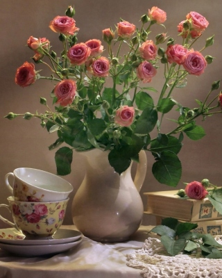 Still life of vintage books and roses Wallpaper for Nokia C1-01