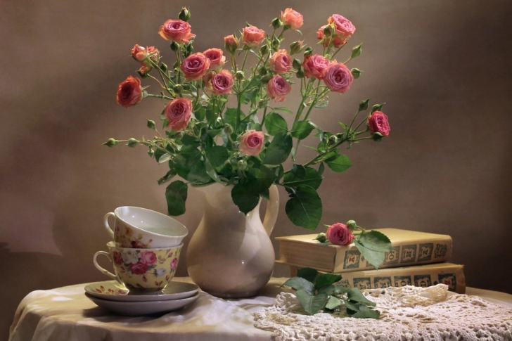 Still life of vintage books and roses wallpaper