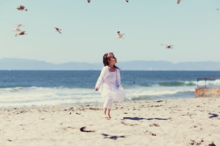 Little Girl At Beach And Seagulls Background for Android, iPhone and iPad