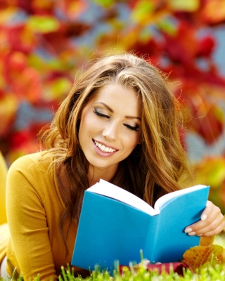 Girl Reading Book in Autumn Park Wallpaper for Nokia Asha 306