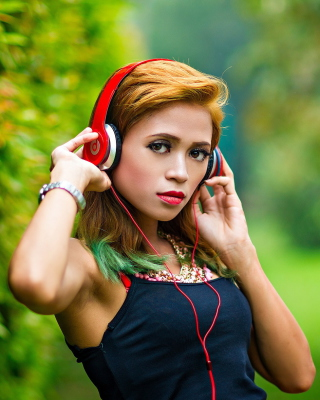 Sweet girl in headphones Wallpaper for Nokia C1-01