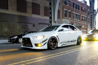 Street racing with Mitsubishi Lancer Evo X Wallpaper for Android, iPhone and iPad