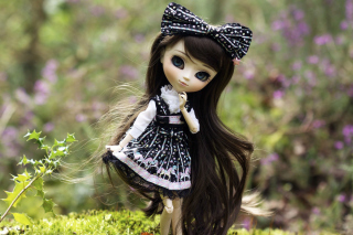 Cute Doll With Dark Hair And Black Bow Wallpaper for Android, iPhone and iPad