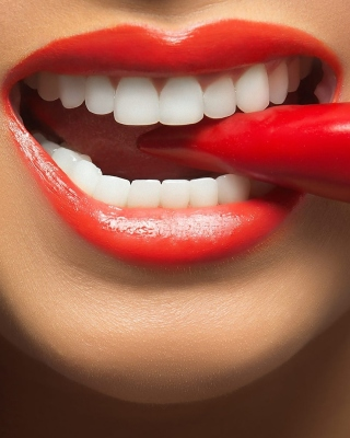 Spicy pepper and lips Background for Nokia Asha 305