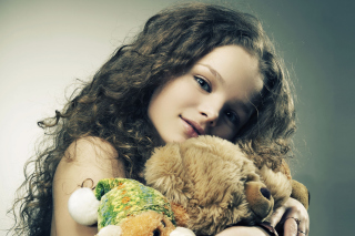 Little Girl With Toys Wallpaper for Android, iPhone and iPad