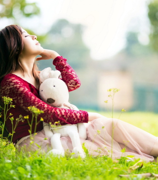 Cute Asian Girl With Plush Rabbit Wallpaper for Nokia Asha 306