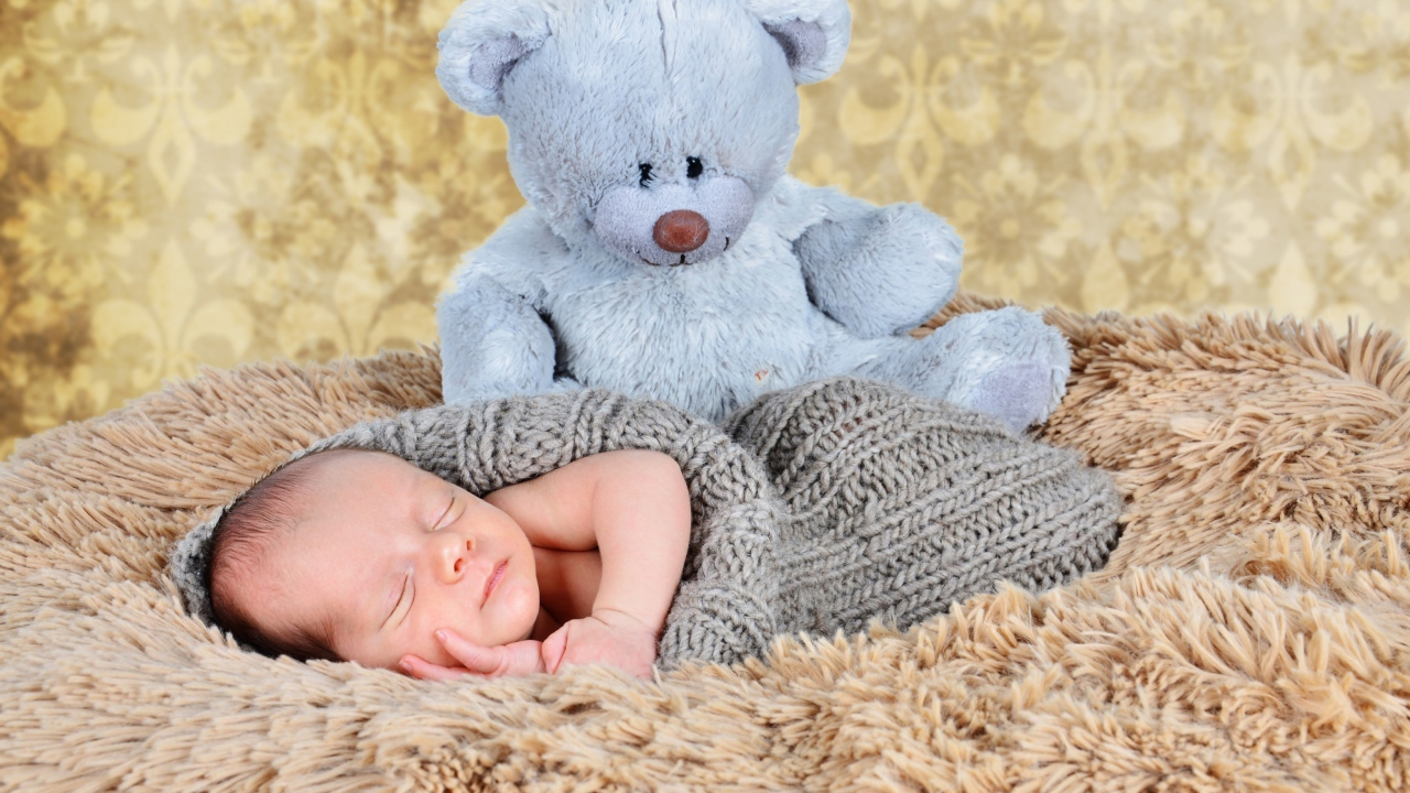 Baby And His Teddy