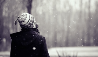 Girl Looking At Falling Snow Wallpaper for Android, iPhone and iPad