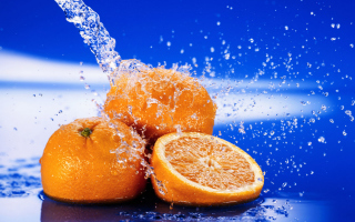 Juicy Oranges In Water Drops Background for Android, iPhone and iPad