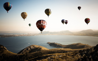 Free Air Balloons In Sky Above Ground Picture for 1366x768