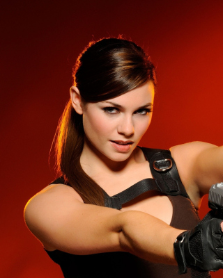 Free Gangster sensual girl with pistol Picture for Nokia Asha 308